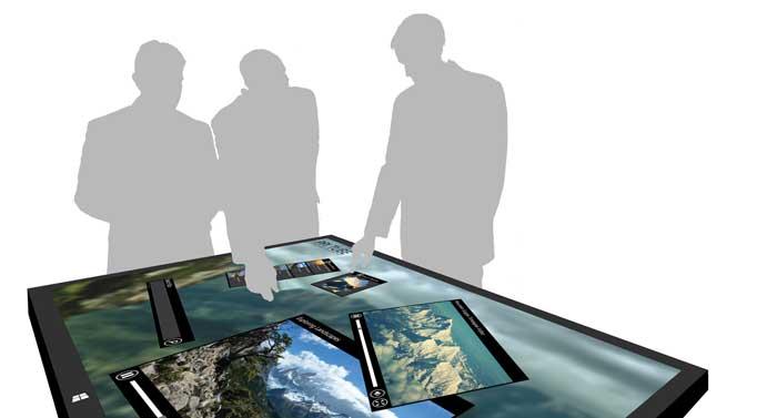 Abbildung 1: Visionärer Arbeitsplatz basierend auf einem Multitouch-Gerät mit der Software bePresenter. Mehrere Personen, die physisch oder virtuell anwesend sind, können gleichzeitig an einem Projekt arbeiten, an einer Sitzung teilnehmen oder eine Präsentation halten. (Quelle: IBV Solutions)